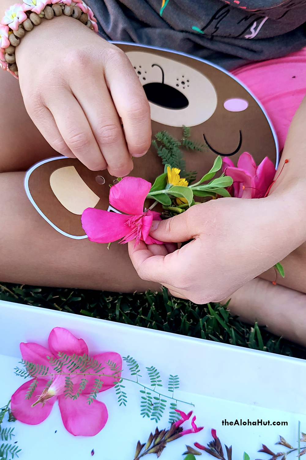 flower crown threading activity by the Aloha Hut